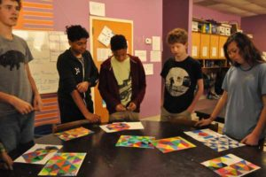 Upper School students discuss an art project