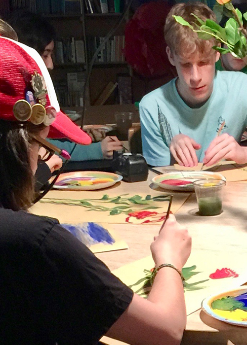 Upper School students painting for art class.