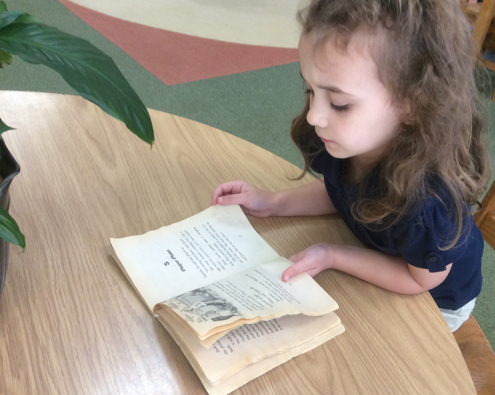 Young student learns to read at Counterpane